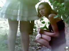 Two spied summer girls urinate outdoors