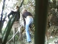 Young girls enjoy peeing in the forest