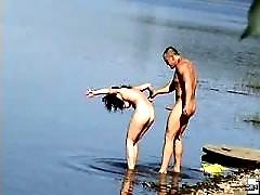 Nude blonde rides her friend on a nude beach