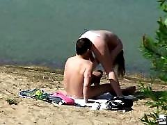 Hot beach life of a nude babe caught on voyeur tape