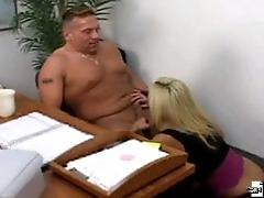 A husky stud gets sucked off by a clothed blonde here