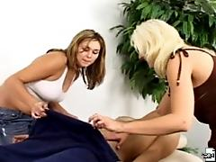 Naked man massaged and fondled by clothed women