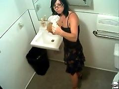 A girl pees in the staff coffeepot and is caught on film