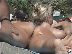 Tanned nude body of a beach beauty caught on spy cam