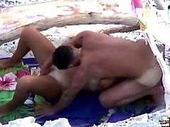 Busty beach babe caught on tape in various positions